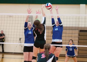 NICE BLOCK - Katie Isham and Cooper Martin go up  for the block. Messenger photo by Jimmy Alford