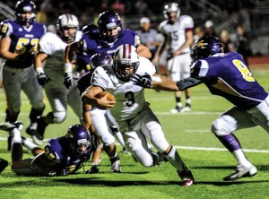 RUN TO THE RECORD BOOK - Bridgeport's Gabe Huerta cuts inside for a few more of his 131 yards against Sanger, enroute to becoming the school's all-time leading rusher. Messenger photo by Joe Duty
