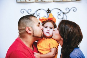 SECOND CHANCE - Loving husband, Eddie Gonzales, delivered 22-year-old Consuelo Rosales from a harmful, drug-using lifestyle. But she says her daughter, Miracle Noelle now 2, will keep her away. After about six years of drug use, Consuelo is going on four years sober. Messenger photo by Joe Duty
