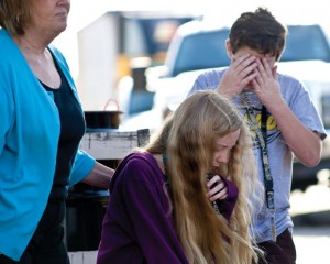 SHOOK UP - A pair of students, Veronica Ellis and Conor Howard, from Chisholm Trail Middle School recover after their school bus was struck from behind at a bus stop in Newark on Farm to Market 718. Messenger photo by Jimmy Alford