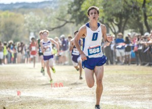 STATE CHAMPIONS - Taylor Clayton closes in on the finish line at the state cross country meet in Round Rock Saturday. The Decatur junior finished third overall and led his team to the state title. Messenger photo by Joe Duty