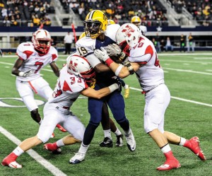 TAKE DOWN - Northwest's Nick Chiofalo and Colton McDonald make the stop Thursday against Arlington Lamar. The Texans season came to an end with a 37-30 loss. Messenger photo by Joe Duty