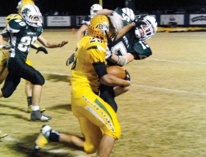 TAKE THAT - Boyd&#039;s Fino Cardona uses a stiff arm to ward off Panther Cody Carmichael in Friday&#039;s 21-0 Yellowjacket victory. Messenger photo by Mack Thweatt