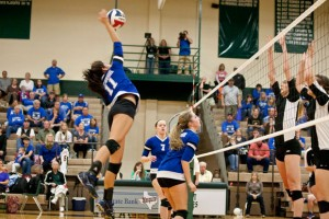 TAKING CHARGE - Makayla Mayfield delivers one of her 17 kills during the Region II final Saturday against Argyle. Messenger photo by Jimmy Alford