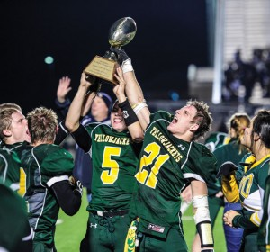 BIG WIN - Boyd's Blake McDonald and Adrian Nelson raise the trophy after the Yellowjackets' first round playoff win against Farmersville. Messenger photo by Joe Duty