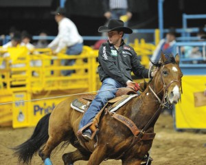 BREAKING AWAY - Decatur cowboy Trevor Brazile, 36, looks to capture a world championship in team roping tonight with partner Patrick Smith, of Lipan. If they win, it will be Brazile&#039;s 18th gold buckle, tying him for most ever with Guy Allen. Brazile already won his 10th all-around world title after only five rounds at National Finals Rodeo. Photo by Kirt Steinke/Western and Rodeo Images