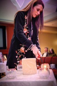 ETERNAL FLAME - Darla French lights a candle in memory of her lost child at The Compassionate Friends memorial last month. Compassionate Friends is holding its 16th annual worldwide candle-lighting on Sunday, Dec. 9. Messenger photo by Joe Duty