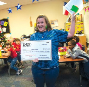 FARM PROJECT - Kindergarten teacher Tiana Lockett shows her joy at receiving the Mesmerizing Mimeo Magic grant that will be used for a farm project for her students. Messenger photo by Joe Duty