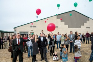 FLY AWAY - Members of Chisholm Trail Baptist Church in Rhome released red, green and white balloons last Saturday in memory of Daniel Barnes. Messenger photo by Joe Duty