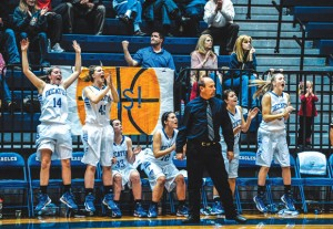GOOD TIMES - The Decatur bench celebrates after Katie Isham hit the game winning shot against Muenster. Messenger photo by Joe Duty