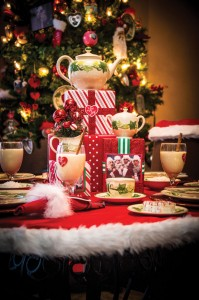 """HAPPY HOLIDAYS - Dallas Blankenship decorated the kitchen and dining area of her home in an """"I Love Lucy"""" theme. The pictured table is set with hand-painted Franciscan Ivy china. Messenger photo by Joe Duty"""