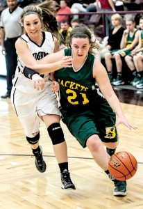 HARD DRIVE - Kallie Tyner makes her way around Bridgeport's Lauren Stowers Tuesday. Messenger photo by Joe Duty