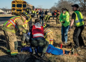 INJURIES - Emergency responders strap several crash victims to backboards just before shipping them to  Wise Regional Health System in Decatur. Messenger photo by Joe Duty