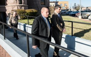 Mark J. Shumski is led out of the courtroom after his conviction and sentencing. Messenger photo by Joe Duty.