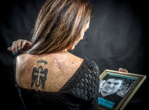 LIVING WITH SUICIDE - Darla French, 45, of Lake Bridgeport, ensured she'd never forget the impact her 19-year-old son Tanner had on her life. She got a tattoo in his memory on her back after he shot and killed himself in February 2011. Messenger photo by Joe Duty