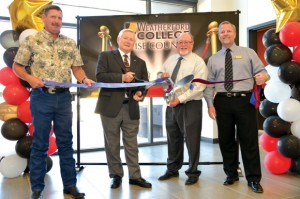 OFFICIALLY OPEN - County Commissioner Kevin Burns (from left), Weatherford College Board Chair Frank Martin, County Judge Bill McElhaney and Weatherford College President Kevin Eaton cut the ribbon at the college's grand opening celebration in September. Messenger photo by Joe Duty