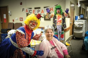 PAINTING SMILES - Brian Bassham of Boyd filled the role of Santa and clown ally to perform with his mother, Carolyn, after his dad, Alvin, died in May. Messenger photo by Joe Duty
