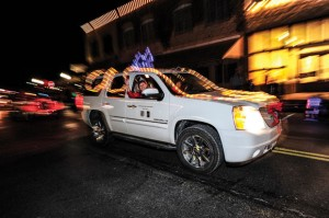 ROYAL WAVE - Mrs. Senior Wise Nellie Redwine waves to the crowd gathered for Bridgeport's lighted Christmas parade Saturday. Redwine earned the title at the Taste of Wise Look Local event in September. Messenger photo by Joe Duty