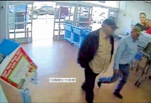 "SECURITY CAMERA PHOTO - An elderly victim identified the men in this photo as the two who approached him in the parking lot of the Decatur Wal-Mart and coerced him into withdrawing a few thousand dollars from his bank account for ""charity."" Submitted photo"