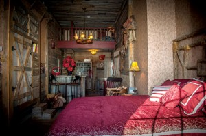 STAY AWHILE - The City Slicker Suite at Courthouse Suites Bed and Breakfast features rustic, western decor giving it the feel of a bunkhouse. Messenger photo by Joe Duty