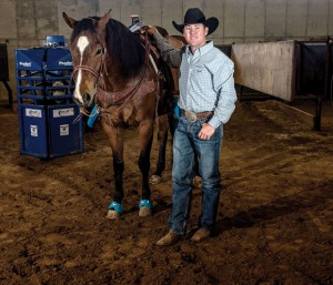 STEP IN THE ARENA - Every year Trevor Brazile, 36, has his Decatur arena modified to match the dimensions found at the Thomas And Mack Center in Las Vegas where he will be competing in the Wrangler National Finals Rodeo, which starts next Thursday. Brazile begins the event ranked first in team roping and all-around. Messenger photo by Joe Duty