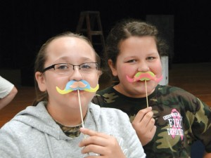 SUPPORTING A CAUSE - Slidell students Cate Zuniga and Camryn Franklin sport colorful mustaches in support of Movember, an effort to raise awareness about prostate cancer. Submitted photo