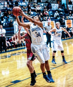 TOUGH GRAB - Decatur's Jasmyne Tate pull down a rebound against Muenster Tuesday. The Lady Eagles won, 39-38. Messenger photo by Joe Duty
