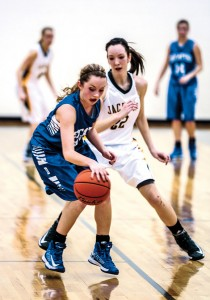 UP THE COURT - Decatur's Stormi Leonard makes her way past the defense of Boyd's Abby Harrell Tuesday. The Lady Eagles went on to a 47-35 victory. Messenger photo by Joe Duty