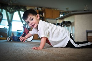 YOUNG STRENGTH - Zaiden Davis, 2, shows resilience in his battle with congenital heart disease. Messenger photo by Joe Duty
