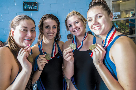 ALL SMILES - Decatur's Haley Dennard, Madeleine Semmelmann, Katey Rowden and Baley Phariss show off their third place medals from the 200 medley relay. Messenger photo by Joe Duty