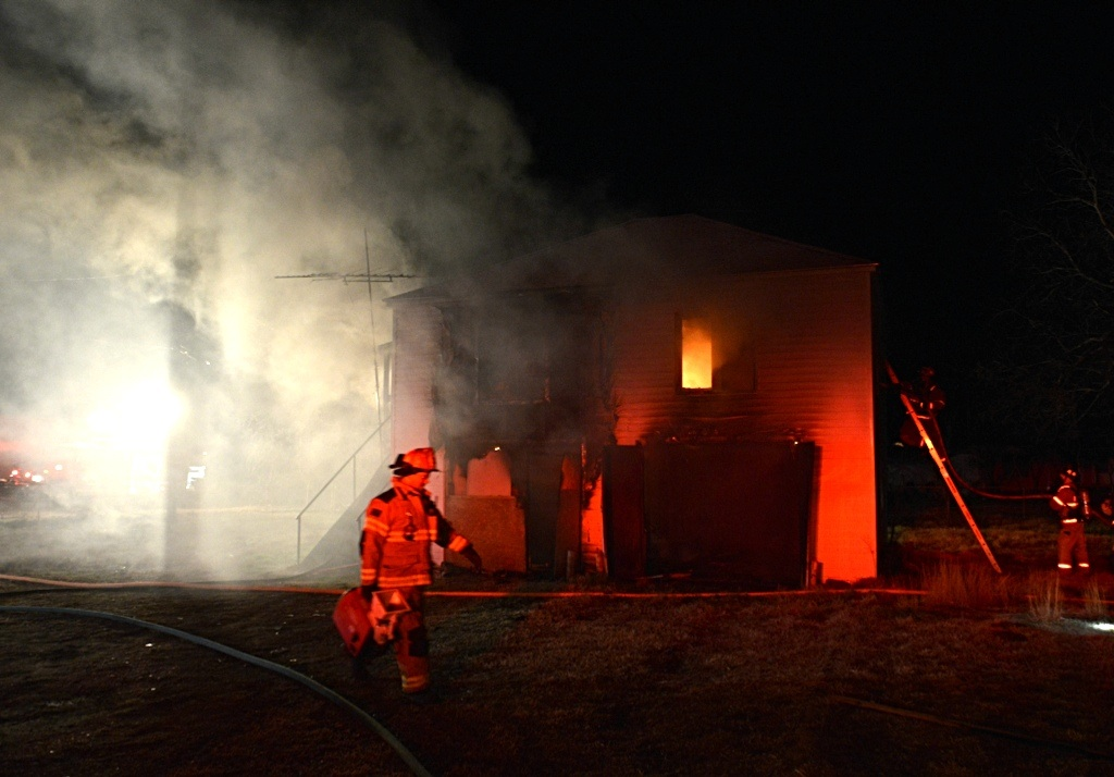 Firefighters battle a fire at a duplex in Alvord Tuesday night.