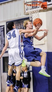 AND ONE - Decatur's Cain Lowe connects after picking up the foul against Krum Friday. Messenger photo by Joe Duty