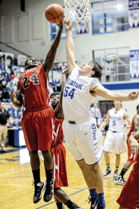 BLOCK PARTY - Decatur's Shayler Carlton blocks a shot from Gainesville's Denzel Johnson Tuesday. The Leopards rallied for a 40-36 victory. Messenger photo by Joe Duty