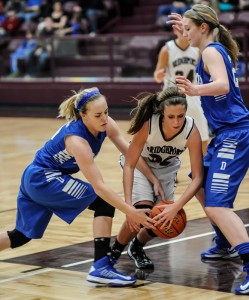 CAUGHT-IN-A-TRAP - Decatur's Murphy Graham and Katie Isham look for the steal against Bridgeport's Landrie Walsh. The Lady Eagles defeated the Sissies, 65-43. Messenger photo by Joe Duty