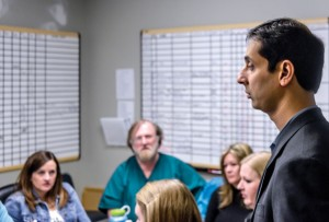COLLABORATING HELP - Haroon Siddique leads a staff meeting of the behavioral health department at Wise Regional Health System in Decatur. The psychiatrist is the medical director of a staff that includes a program director, social workers, clinical therapists, social workers, psychiatric nurses and counselors. Messenger photo by Joe Duty