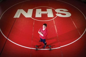 DETERMINED TO COMPETE - Marshall Austin lost 80 pounds to become eligible for the Northwest wrestling team. The junior and Aurora native has a 19-10 record. Messenger photo by Joe Duty