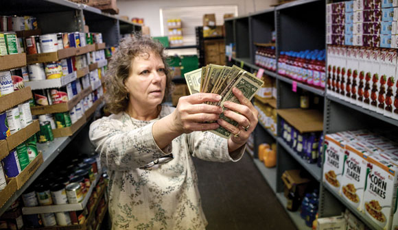 DONATION DOLLARS - WARM Director Ren  Ashmore says 90 to 92 percent of every dollar donated to the food pantry goes back into the community in some form of assistance. This year WARM is facing a $20,000 budget deficit and is seeking help. Messenger photo by Joe Duty
