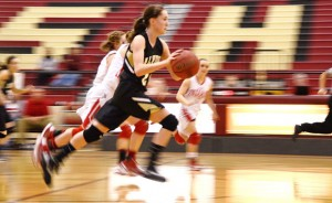 FULL SPEED - Alvord's Marissa Schedcik runs down the floor during the Whataburger Tournament Saturday. Messenger photo by Mack Thweatt