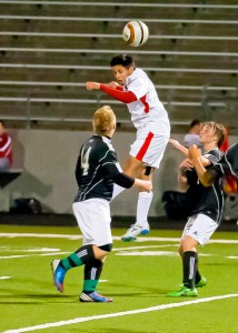 HEADS UP - Marco Rodriguez deflects a punt from the Azle keeper to put the balls back in the Texans control. Messenger photo by Jimmy Alford