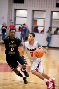 MAKING HIS WAY - Northwest's Josh Tatum scored 16 points to help the Texans lead Fossil Ridge. Messenger photo by Jimmy Alford