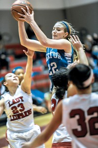 OPEN LOOK - Decatur&#039;s Katie Isham looks for an open teammate against Gainesville Friday.  Messenger photo by Joe Duty