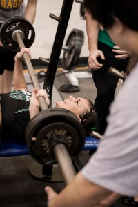 RAISING THE BAR - Paradise's Ashley Sparks takes part in the bench press at the Chico Powerlifting Meet Saturday. Sparks finished fourth in her class. Messenger photo by Jimmy Alford