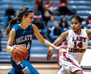 ROUGH START - Decatur's Haley Dennard dribbles past Gainesville's Chandler Kemp during Friday's district opener in Gainesville. The Lady Eagles lost to the Lady Leopards 57-44. Messenger photo by Joe Duty