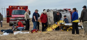SAD SCENE - Emergency responders and investigating officers responded to a wreck Friday morning that killed an infant and sent two more to a Fort Worth hospital by helicopter. Messenger photo by Joe Duty