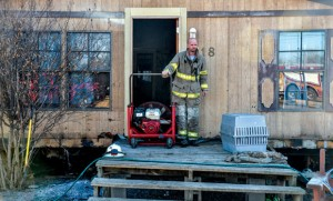 SAVED HOME - A fire that broke out underneath a mobile home Wednesday on Rogers Road in Newark was contained to the undercarriage thanks to the quick response of Newark and Rhome firefighters. The cause of the fire is unknown. Messenger photo by Joe Duty