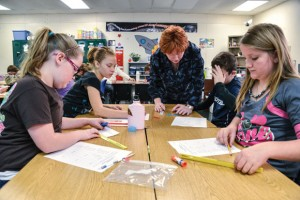 SCOPED OUT - Boyd fifth-grade veteran math and science teacher Nelda Cope said CSCOPE has helped her better sequence lessons. Tuesday morning, students (from left) Lindsay Carroll, Brianna Herring, Dalton Westray and Cortney Clamon practice group work. Messenger photo by Joe Duty
