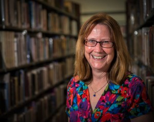 STANDING IN THE STACKS - Pat Peters of Denton is settling in at the Decatur Public Library this week. The city recently hired Peters as library director, replacing Cecilia Barham who resigned in October. Messenger photo by Joe Duty