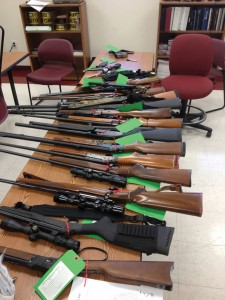 STOCKED UP - Bridgeport police confiscated 13 firearms and lots of ammunition from the home of James Warden, 43, after a tense standoff ended peacefully Tuesday morning. 