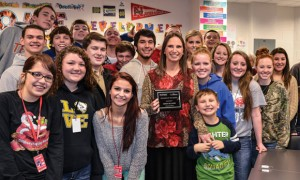 STUDENT SUPPORT - Students of Gwen Hilliard, center, nominated their teacher for the KLTY/CareNow Teacher of the Month award. Also pictured is Hilliard's 6-year-old son, Joshua. Hilliard is the second Northwest ISD teacher selected for the award this school year. Messenger photo by Joe Duty