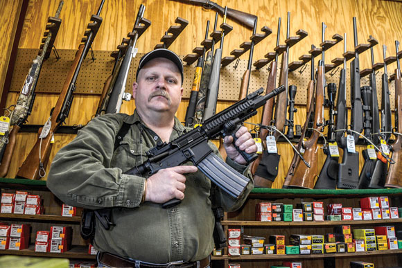 THE NEW CURRENCY - Bridgeport Guns and Ammo owner Brian Bernardo said he's seen a tremendous spike in the sale of guns and ammunition since the president began pushing tough gun legislation. Bernardo is also in law enforcement, and he believes stricter gun legislation does not keep weapons out of the hands of criminals. Messenger photo by Joe Duty